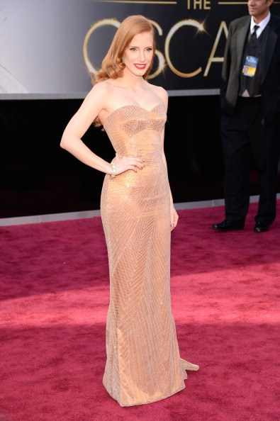 Jessica Chastain at the 85th Academy Awards, 2013, wearing Armani Privé and Harry Winston jewellery. Sh was nominated for Best Actress for Zero Dark Thirty