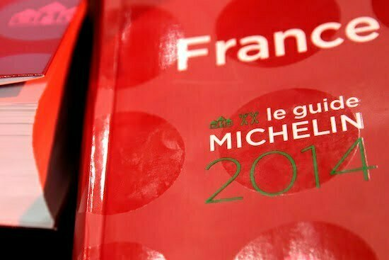 Copies of the new 2014 annual Michelin restaurant guide are presented in Paris