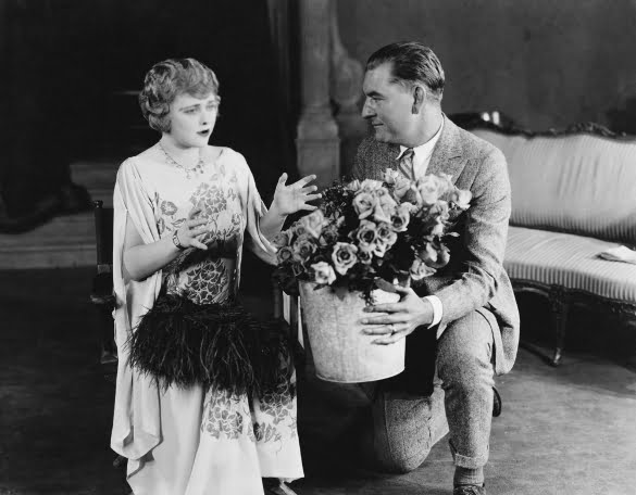 man giving flower