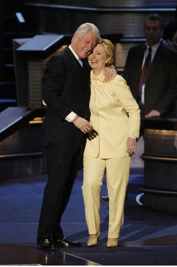 Former President Bill Clinton hugs his wife, Sen. Hillary Cl