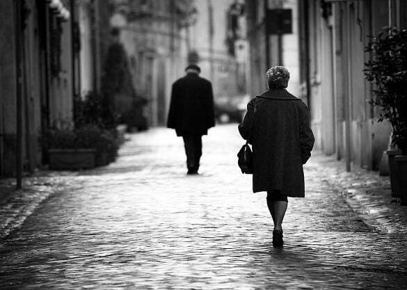 A man and woman walking away
