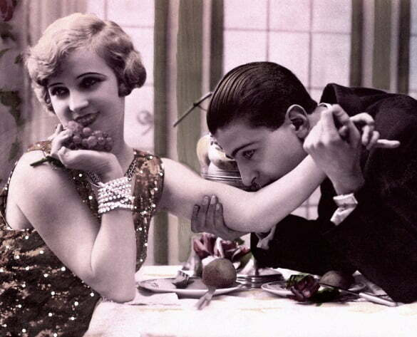 Man kissing woman's arm