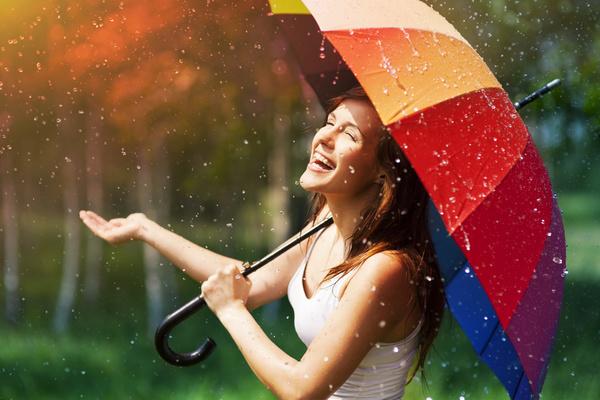 Happy-woman-in-the-rain-Stock-Photo