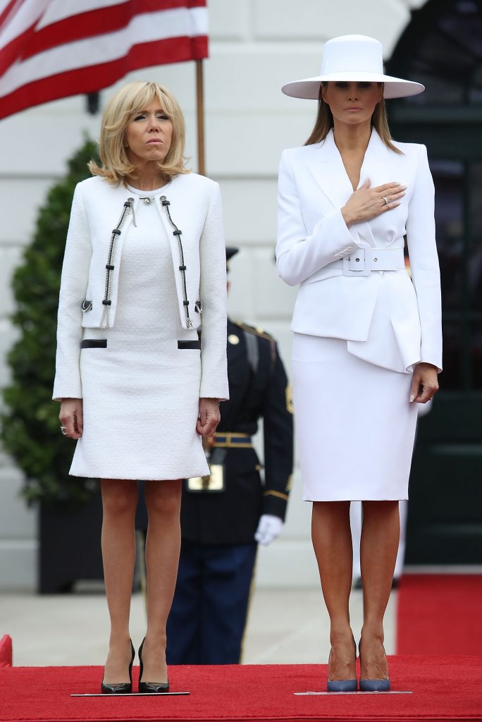 WASHINGTON, DC - APRIL 24: U.S. first lady Melania Trump welcomes French first lady Brigitte Macron, during an arrival ceremony at the White House April 24, 2018 in Washington, DC. Trump is hosting Macron for a two-day official visit that included dinner at George Washington's Mount Vernon, a tree planting on the White House South Lawn and a joint news conference. (Photo by Mark Wilson/Getty Images)