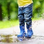 Toddler jumping in pool of water