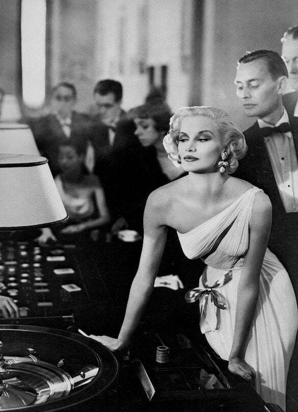 Evening gown by Madame Grès at the tables in the Casino at Le Touquet, photo by Richard Avedon, 1954